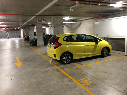 Secure car park, well lit and close to transport
